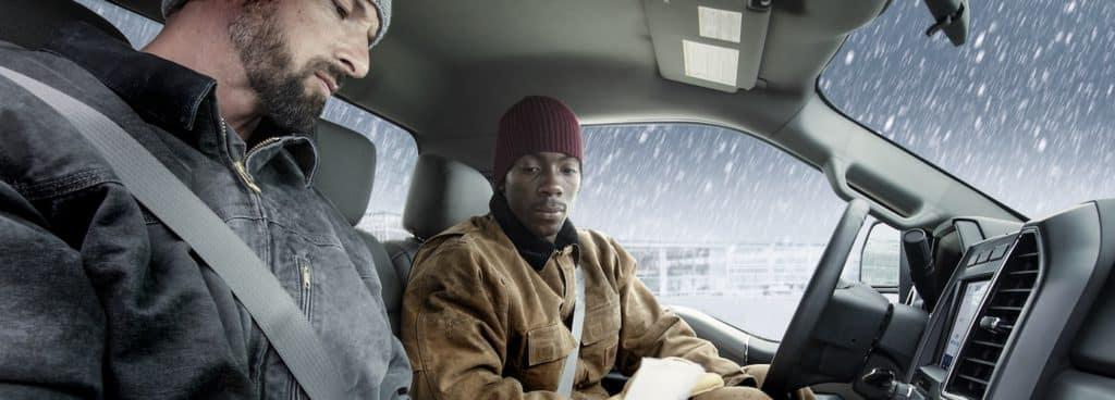 Men in Cold in Truck