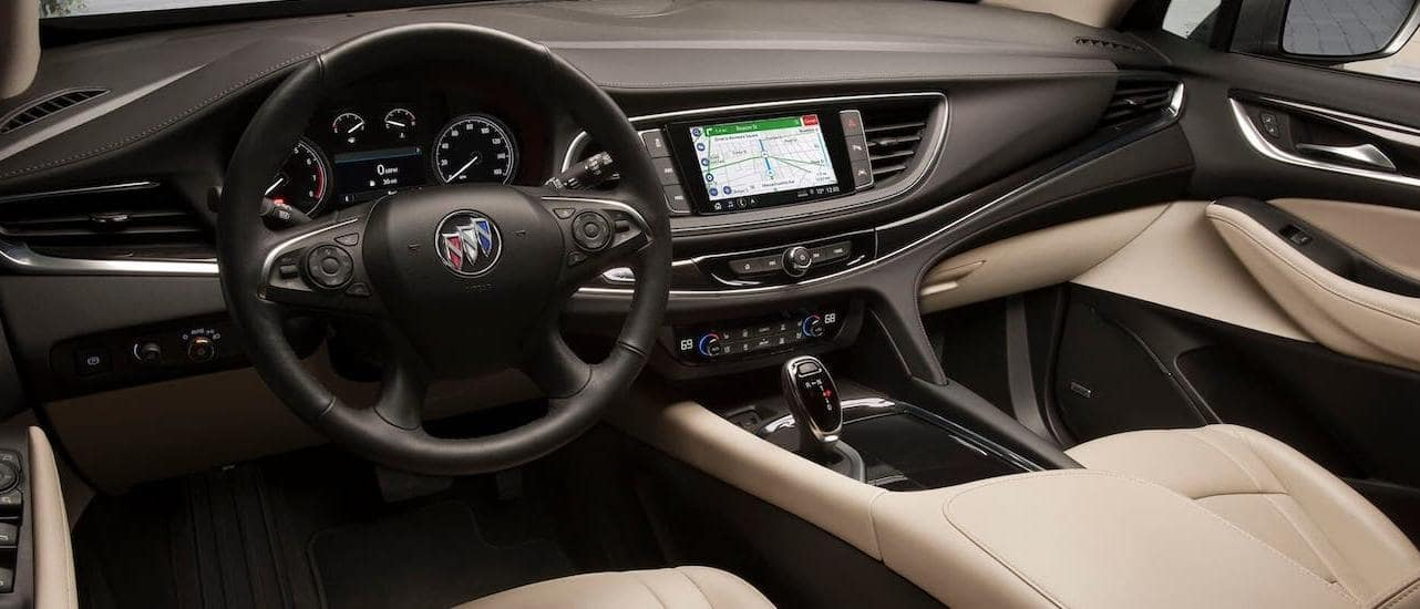 A black and tan interior of a 2020 Buick Enclave is shown.