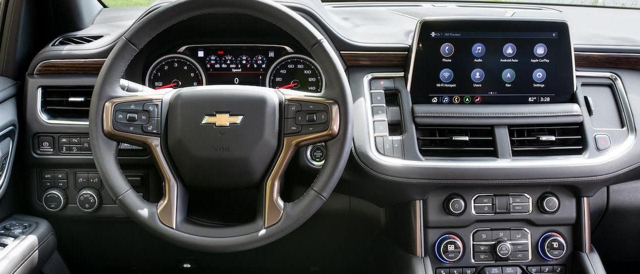 The steering wheel and dashboard are shown in a 2021 Chevy Tahoe that is at a Chevy dealer near Lexington, KY.