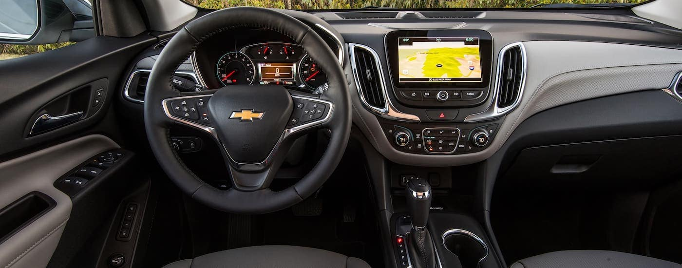 The steering wheel and dashboard of a 2020 Chevy Equinox are shown.