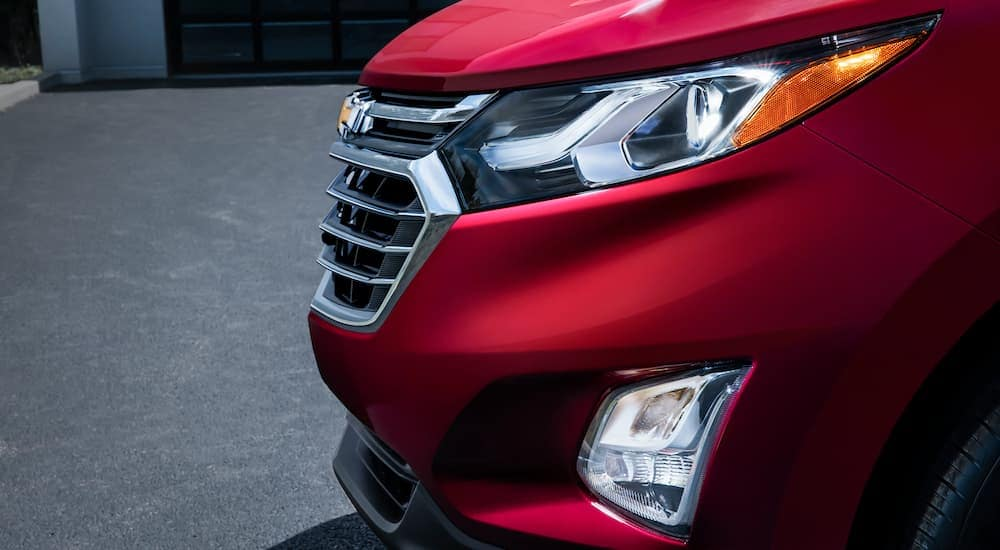 A close up is showing the front end of a 2018 used Chevy Equinox.