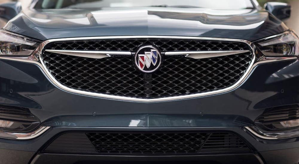 A closeup shows the grille on a gray 2019 used Buick Enclave Avenir.