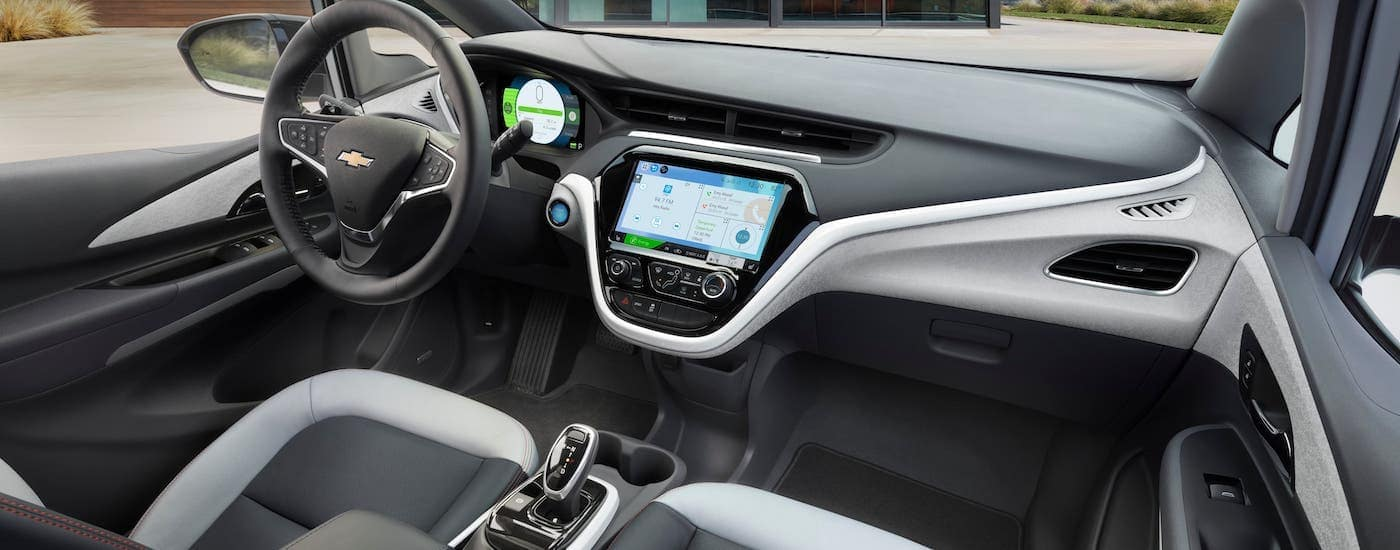 The gray and black interior of a 2021 Chevy Bolt EV is shown.