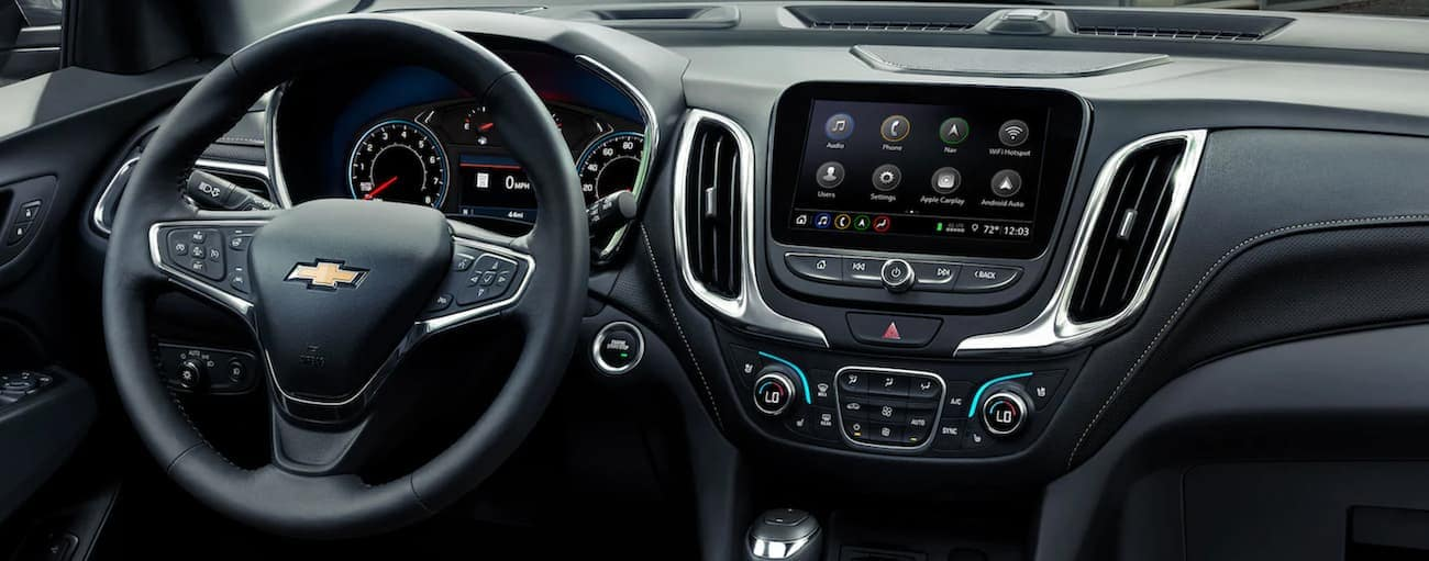 The wheel and dashboard in a 2021 Chevy Equinox are shown.