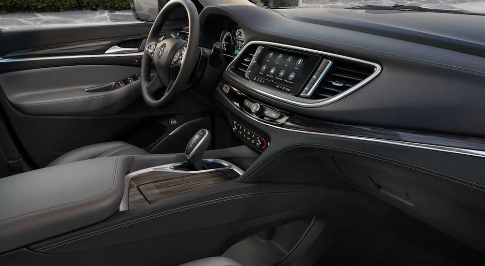 The grey interior of a 2021 Buick Enclave is shown.