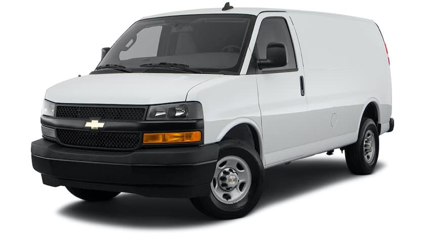 A white 2021 Chevy Express Van is angled left.