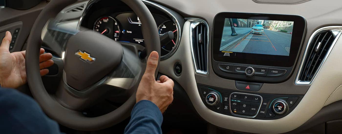 A close up shows the infotainment screen and back up camera on a 2021 Chevy Malibu.