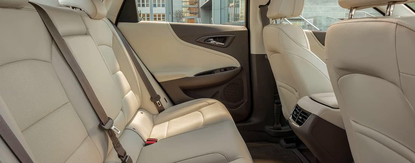 The tan interior is shown from the passenger side of a 2021 Chevy Malibu.