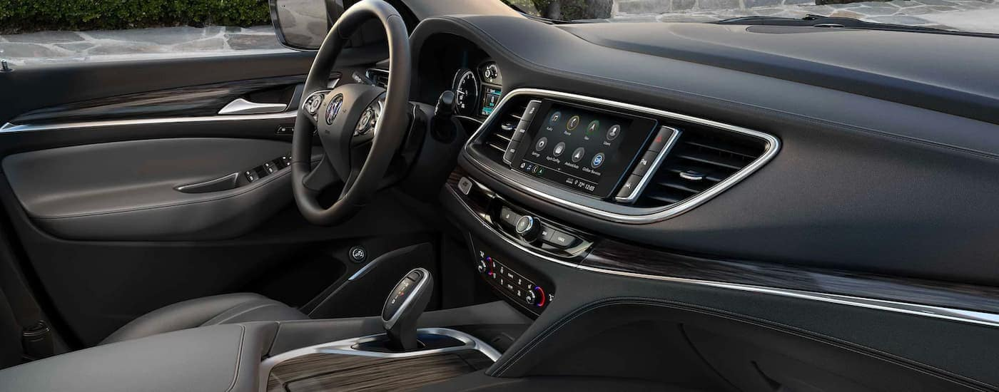 The center console and black interior is shown in a 2021 Buick Enclave.
