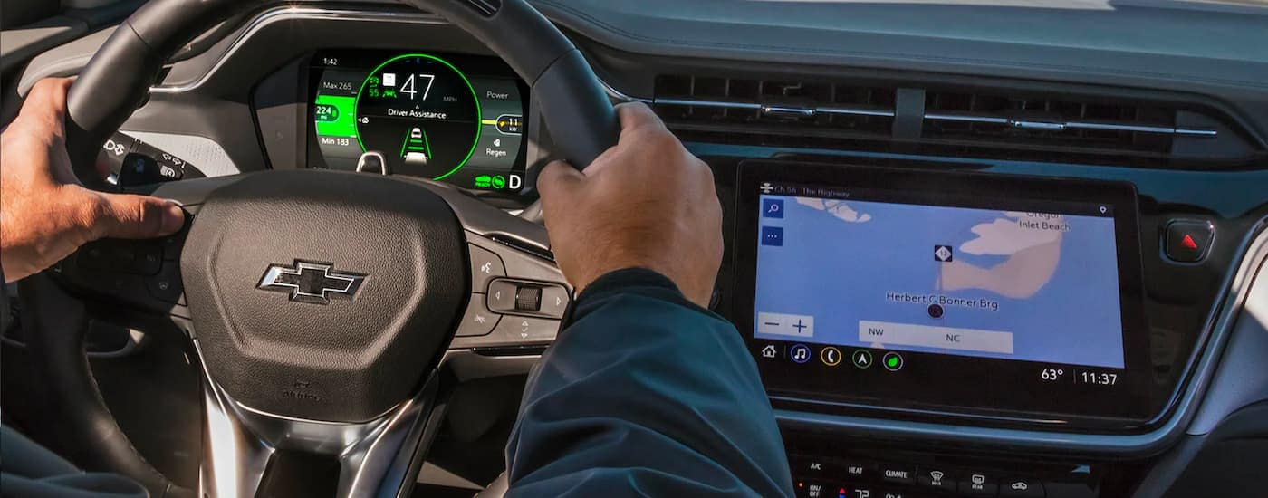 A close up shows the steering wheel and infotainment screen in a 2022 Chevy Bolt EUV.