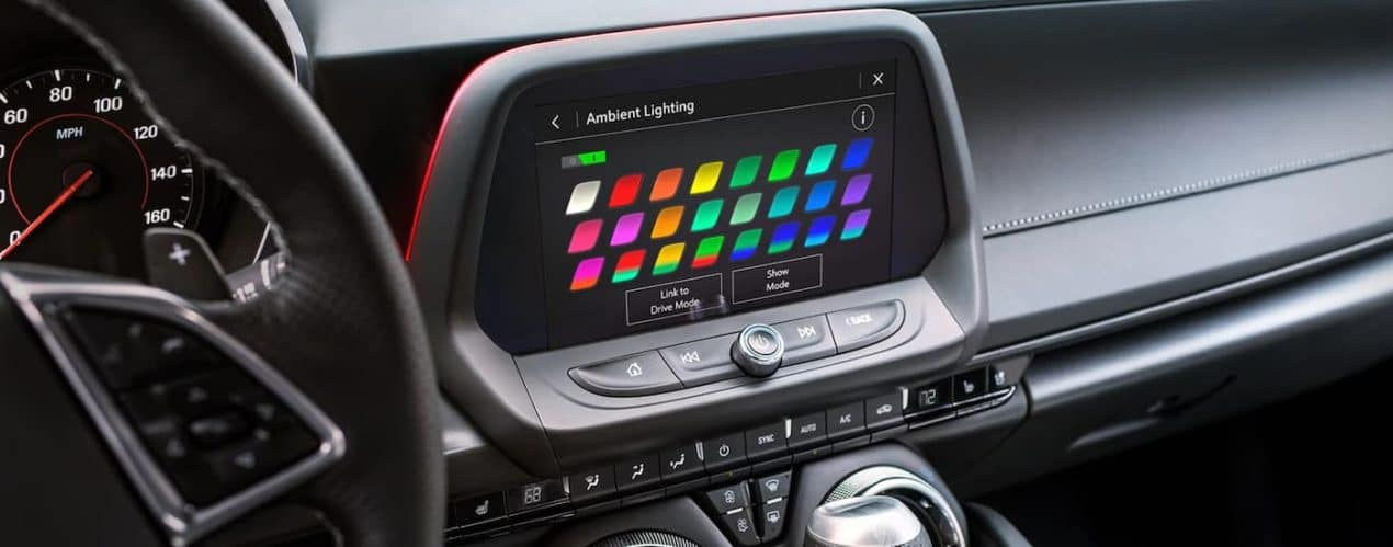 The ambient lighting selections are shown on the infotainment screen of a 2021 Chevy Camaro.