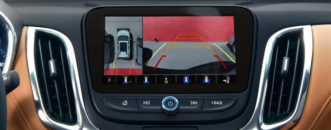 A close up shows the infotainment screen and backup camera view in a 2021 Chevy Equinox.
