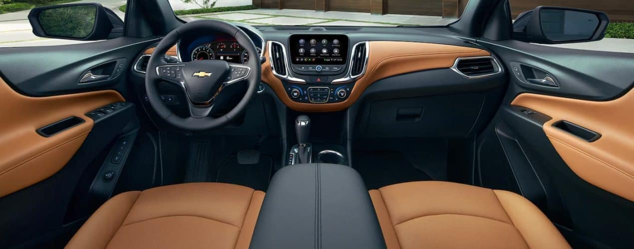 The black and brown interior is shown in a 2021 Chevy Equinox.
