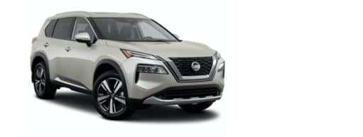 A white 2021 Nissan Rogue Platinum is angled right.