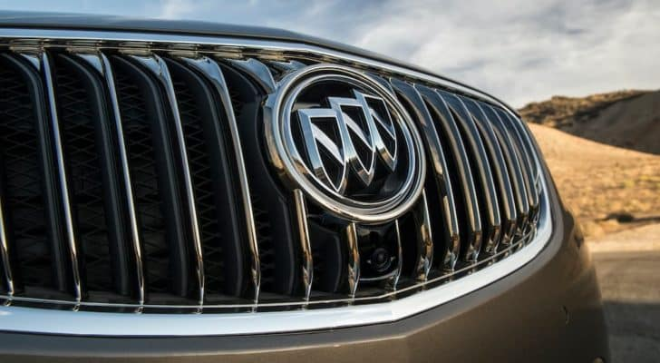 A close up shows the grille and Buick badge on a grey 2016 Buick Envision.