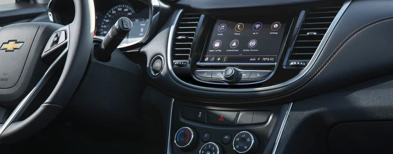 A close up shows the infotainment screen and apps in a 2022 Chevy Trax.