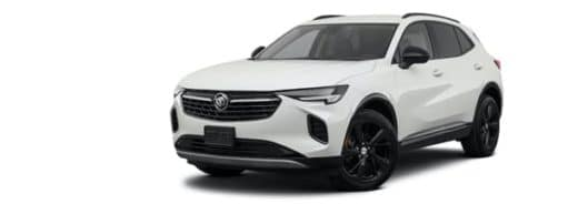A white 2021 Buick Envision is angled left after winning a 2021 Buick Envision vs 2021 Ford Edge comparison.