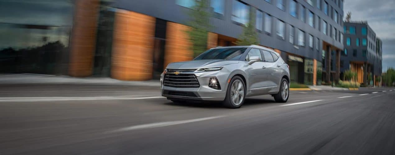 A silver 2022 Chevy Blazer Premier is shown driving on a city street.