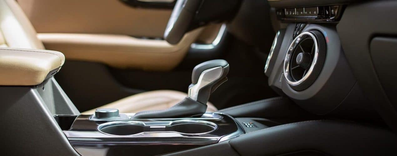 A close up shows the shifter and vents in a 2022 Chevy Blazer RS.