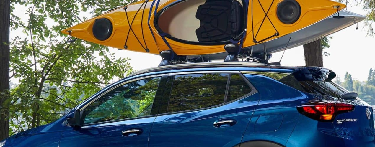 A blue 2022 Buick Encore GX is shown with a kayak on the roof.