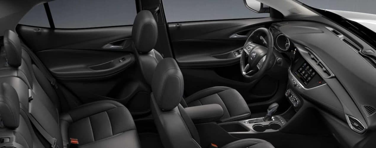 The black interior of a 2022 Buick Encore GX shows two rows of seating.