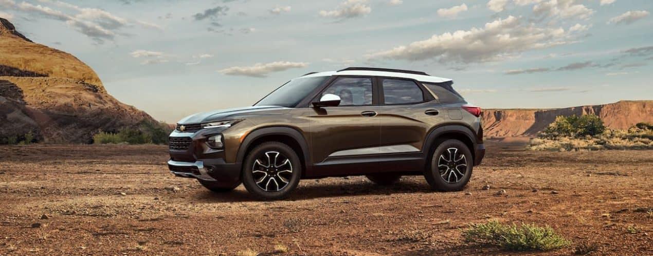 A bronze 2022 Chevy Trailblazer ACTIV is shown parked in a desert.