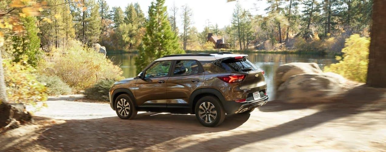 A bronze 2022 Chevy Trailblazer ACTIV is shown from the side parked next to a lake.