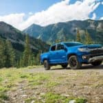 A blue 2022 Chevy Colorado Trailboss is shown parked in the mountains after leaving a Chevy dealer in Lexington KY.