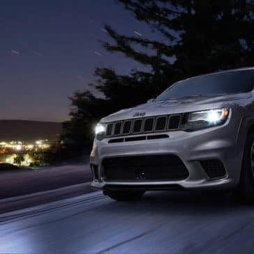 2018 Jeep Grand Cherokee on the highway at night