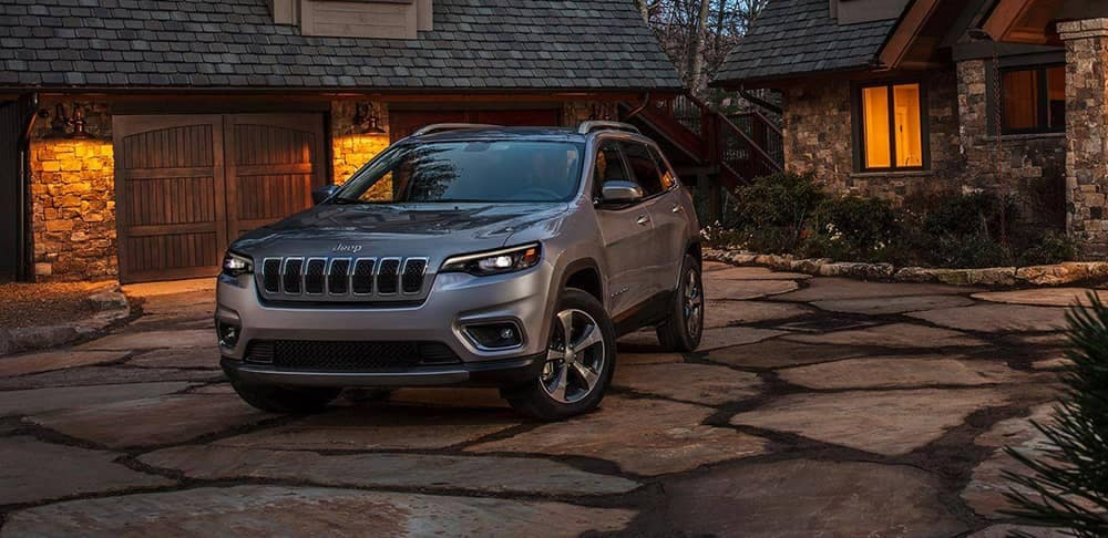 2019 Jeep Cherokee in driveway at dusk