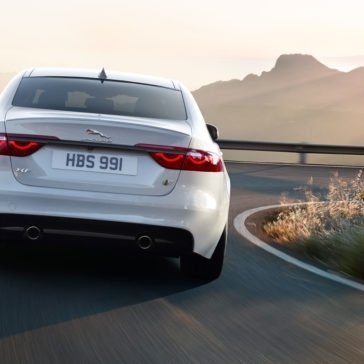 2018 Jaguar XF rear end view driving