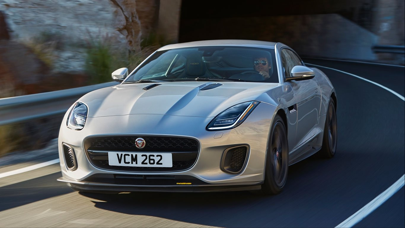 Man driving a 2018 Jaguar F-TYPE Coupe