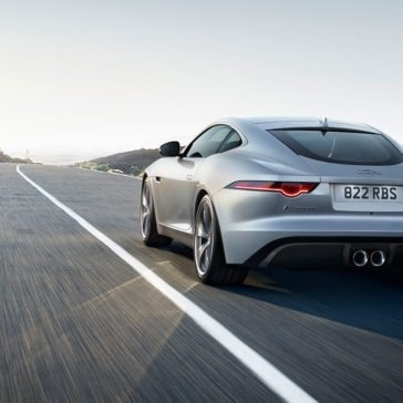 2018 Jaguar F-TYPE Coupe driving rear view