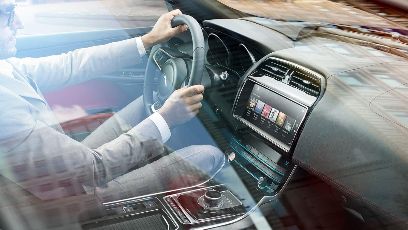 Man Driving a 2019 Jaguar XE