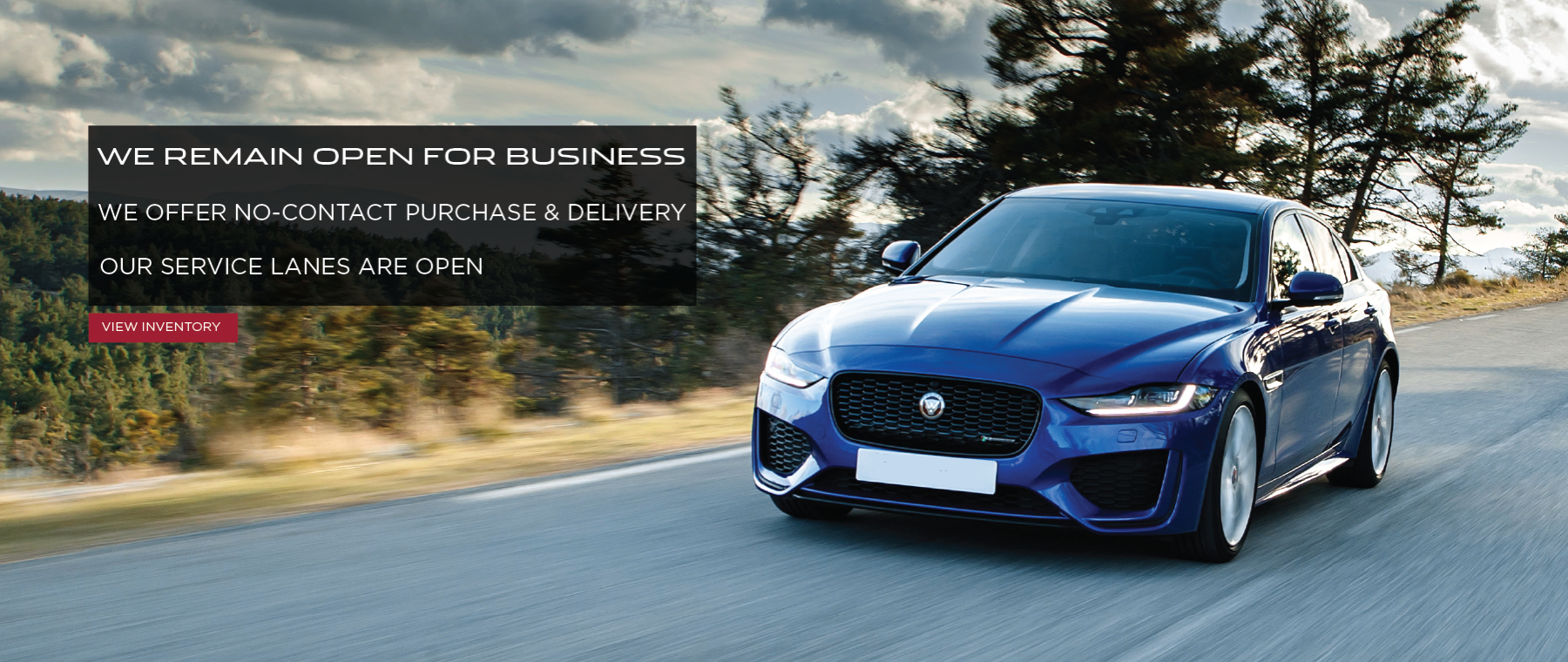Blue 2020 Jaguar XE on road near trees, We are open. Click to view inventory.