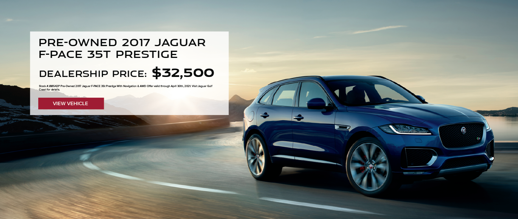 Blue Pre-Owned 2017 Jaguar F-PACE 35t Prestige With Navigation & AWD on curving road. Click to view vehicle.