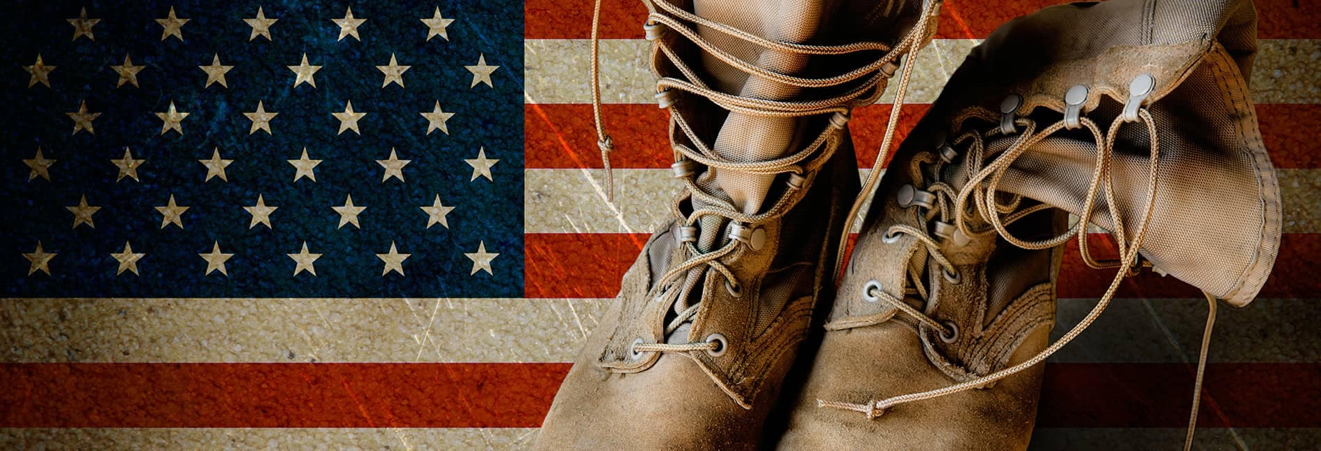 Military boots on American flag
