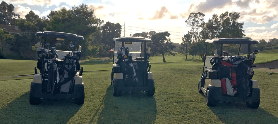 golf carts packed with golf bags for Holes for Heroes event