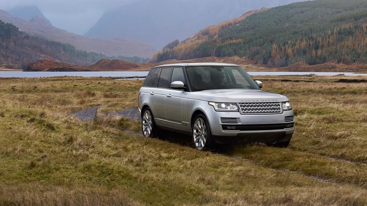 2017 Land Rover Range Rover driving through a field