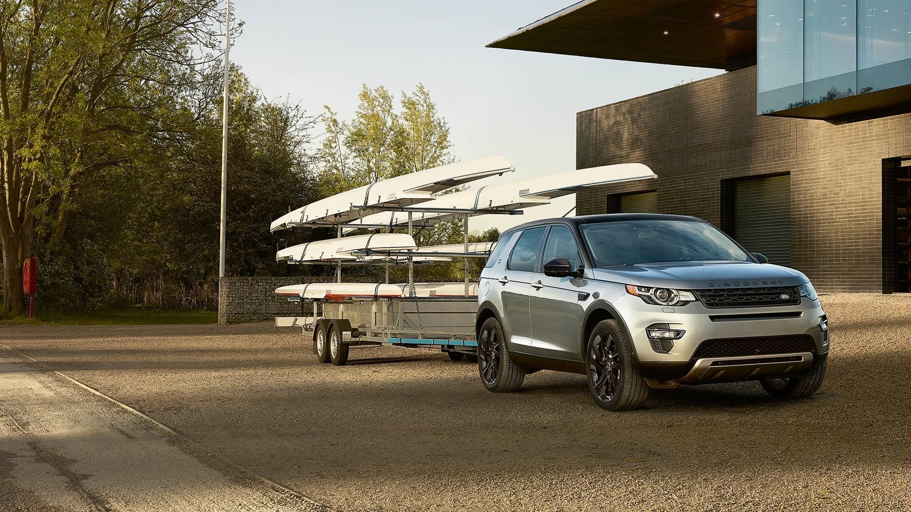2017 Land Rover Discovery Sport towing a rack of canoes