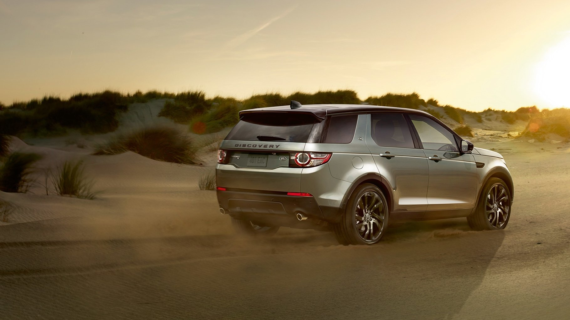 2017 Land Rover Discovery Sport driving down a dirt road