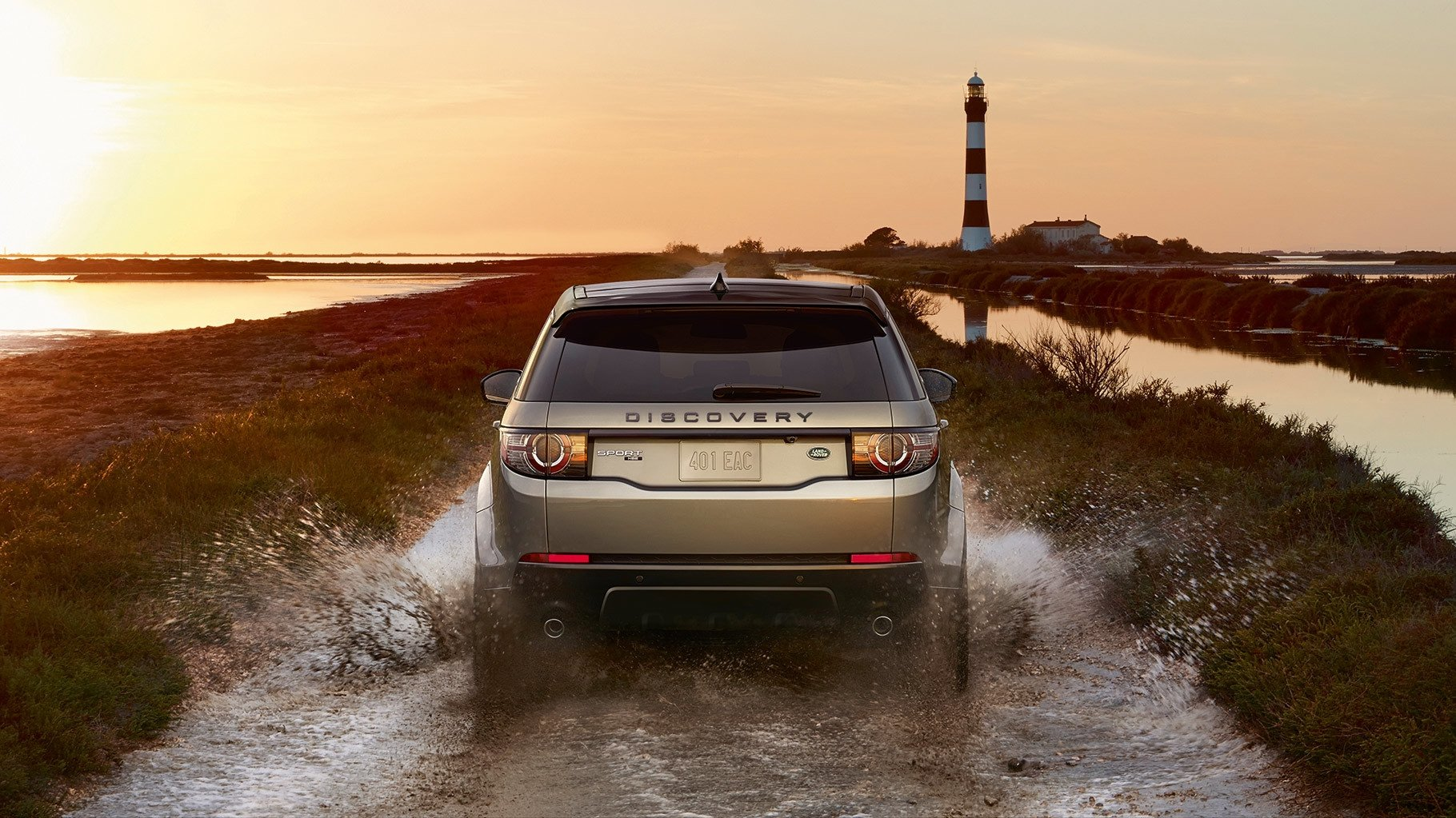 2017 Land Rover Discovery Sport rear end view driving through water