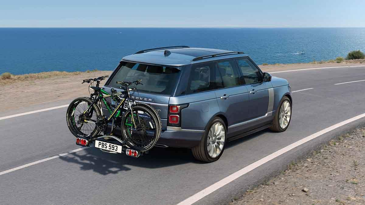 2018 Land Rover Range Rover driving with bikes on rack