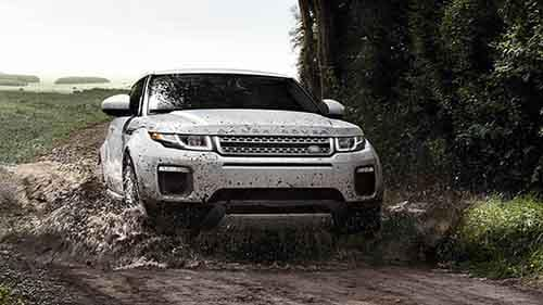 2018 Land Rover Range Rover Evoque off-roading through mud