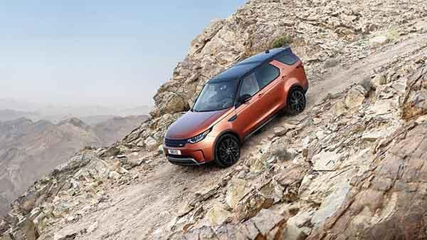2018 Land Rover Discovery driving down inclined rocky hill