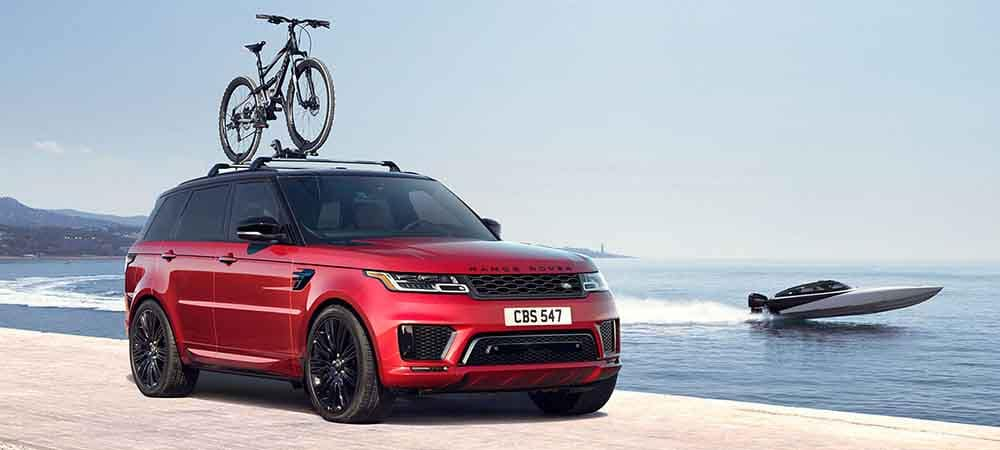 2018 Land Rover Range Rover Sport carrying a bike on roof rails