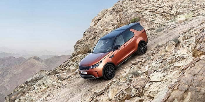 2018 Land Rover Discovery off-roading down a rocky hill