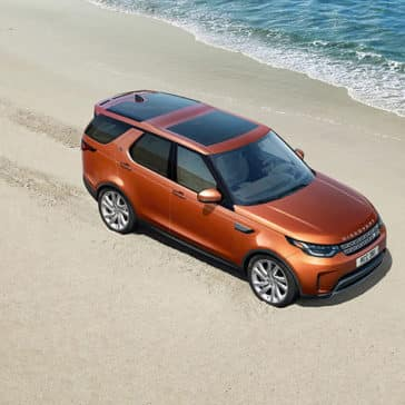 2019 Land Rover Discovery Driving on the Ocean