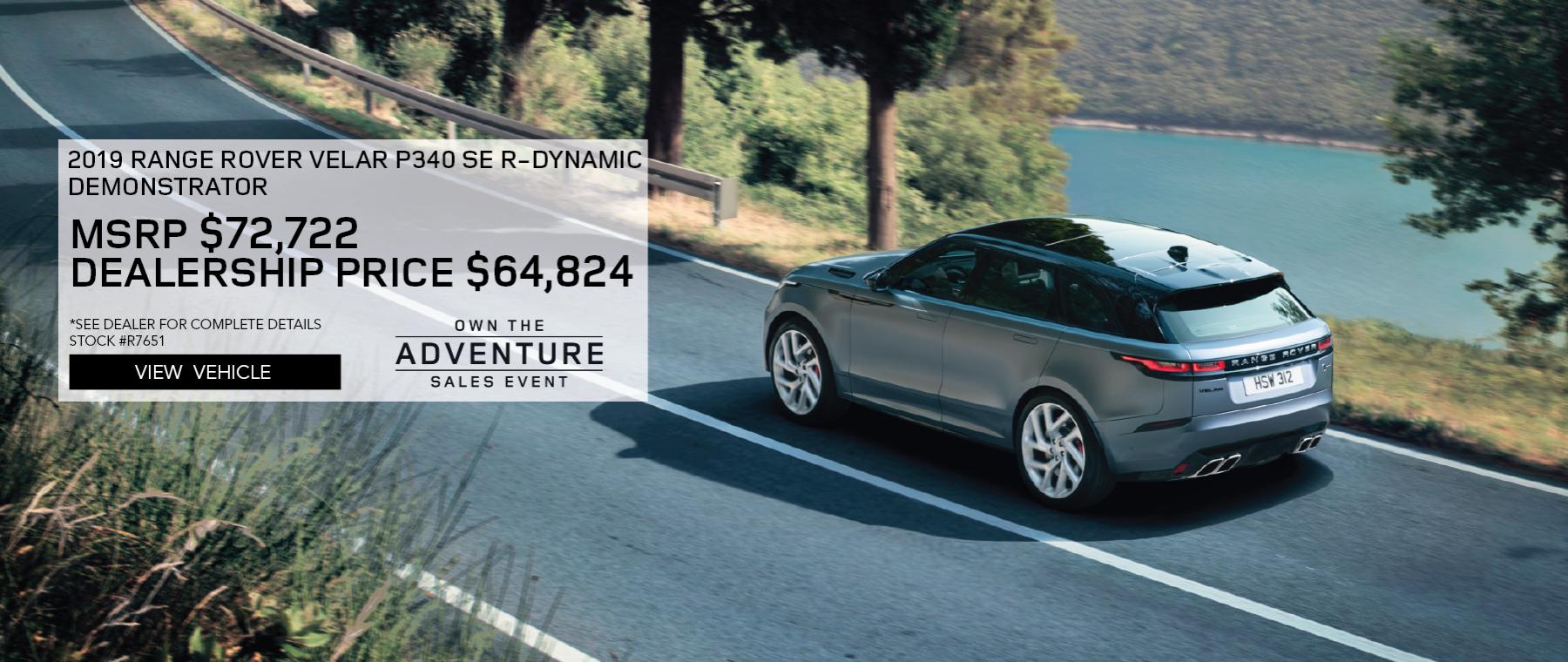 Grey 2019 Range Rover Velar P340 SE R-Dynamic with Navigation on road near lake. MSRP $72,722 Dealership Price $64,824 Stock #  R7651 *See dealer for complete details Offer Expires 2/29/2020