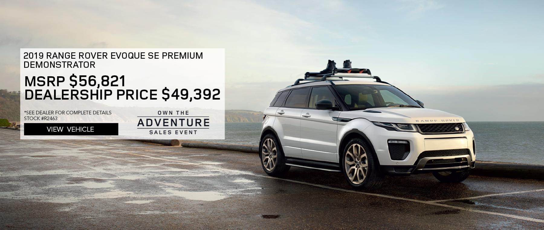 White 2019 Range Rover Evoque SE Premium with Navigation on foggy road. MSRP $56,821 Dealership Price $49,392 Stock #R2463. See dealer for complete details. Offer Expires 2/29/2020
